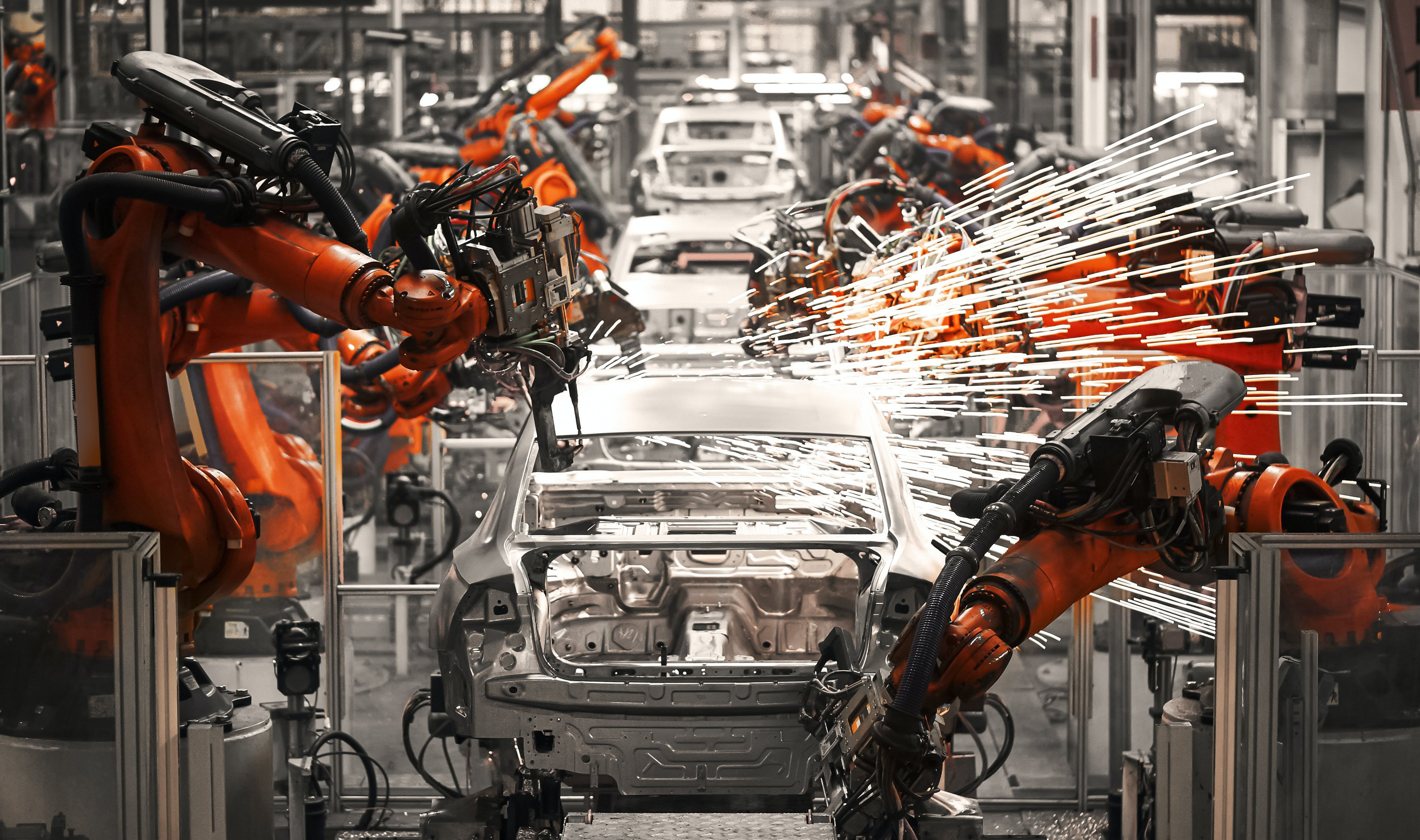inside a automobile factory with robotic arms