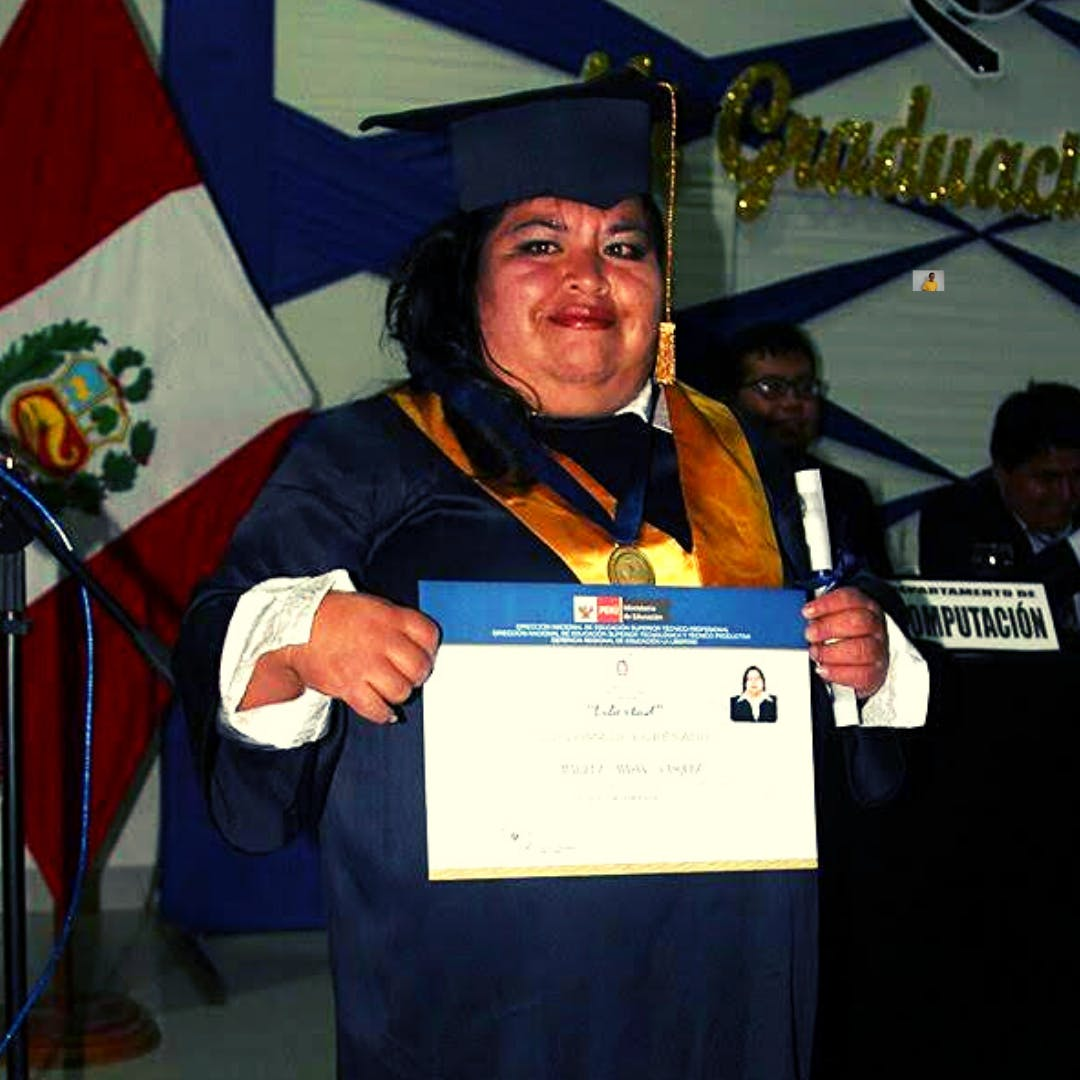 Mariluz a HOPE Scholar who lives with a disability receives a computer degree at her graduation.